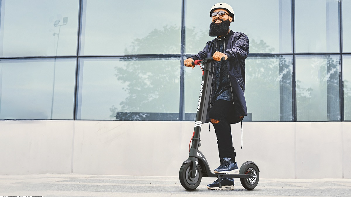 Guy wearing a helmet riding the Swagger 7T Transport