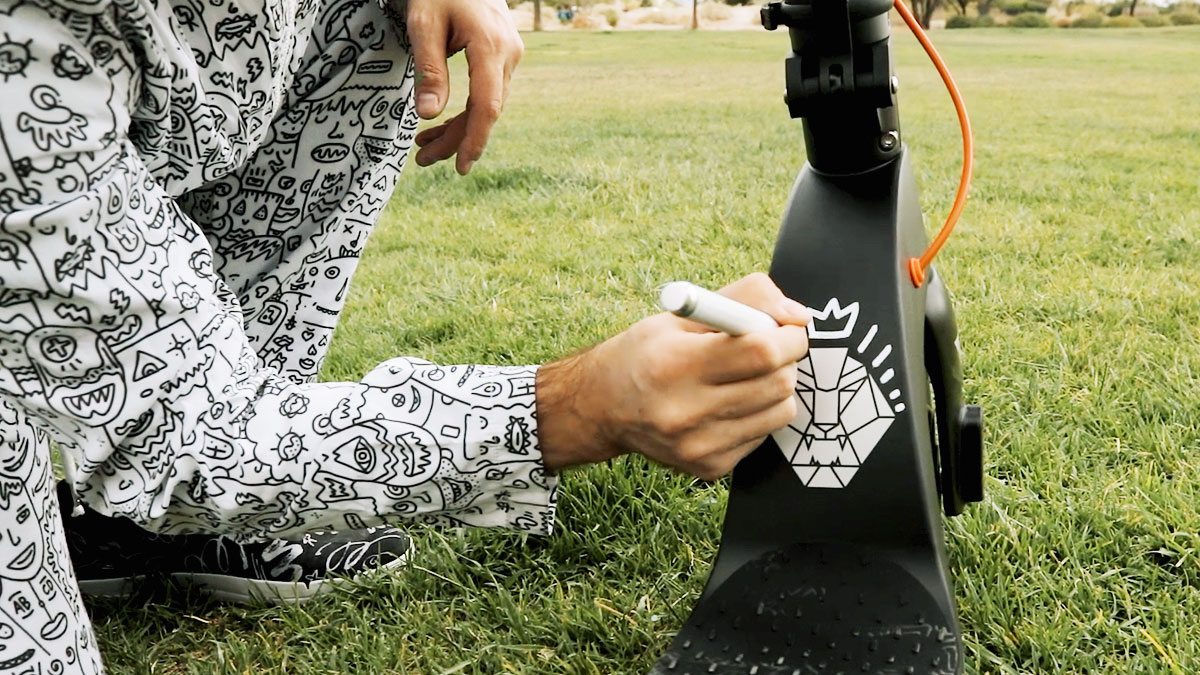 Artist Pretty Done drawing the swag lion logo on his Swagger 7T