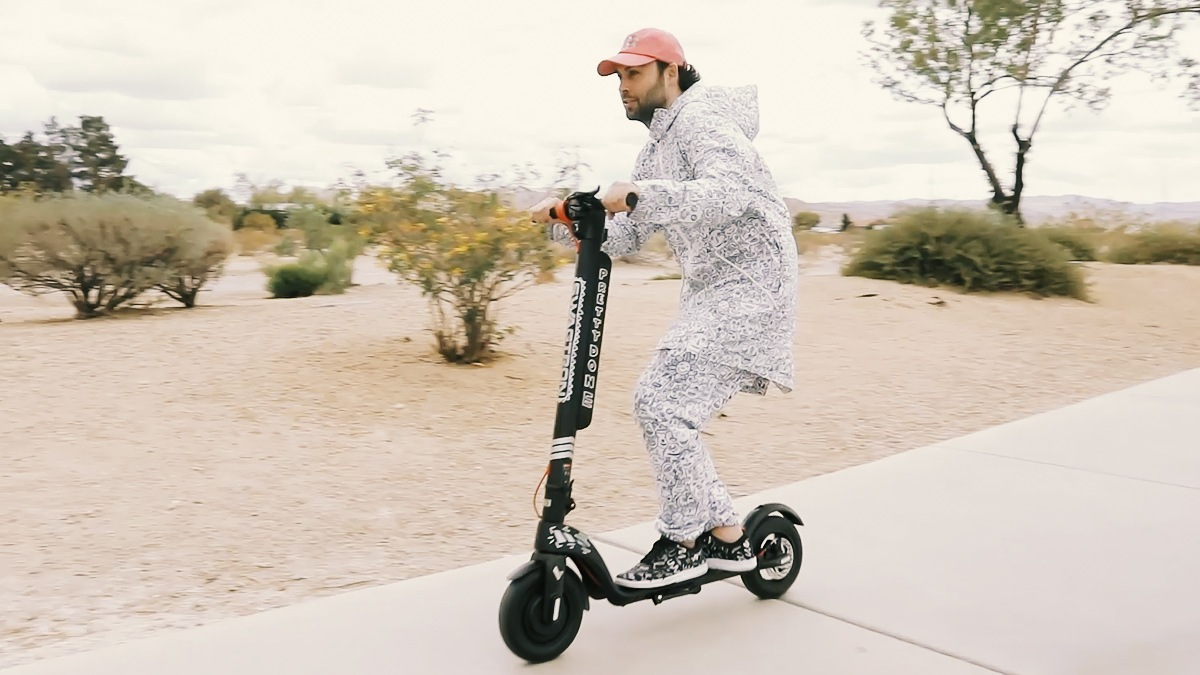 Artist Pretty Done riding on his Swagger 7T electric scooter