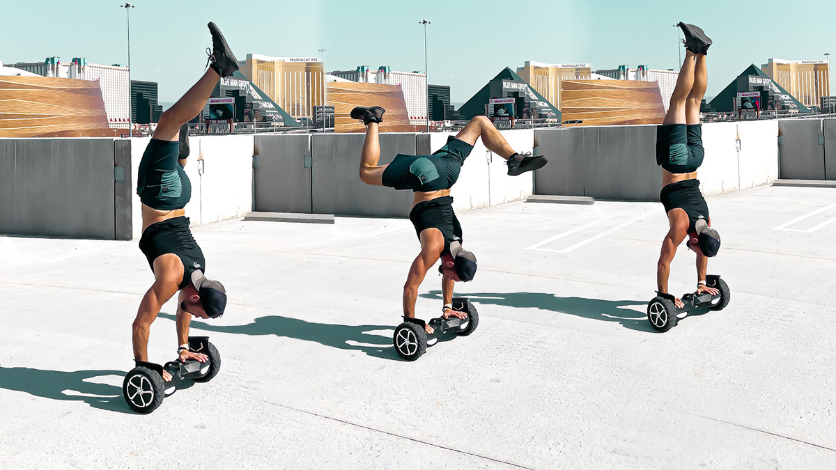 Travis Brewer doing handstands on his T6 hoverboard.