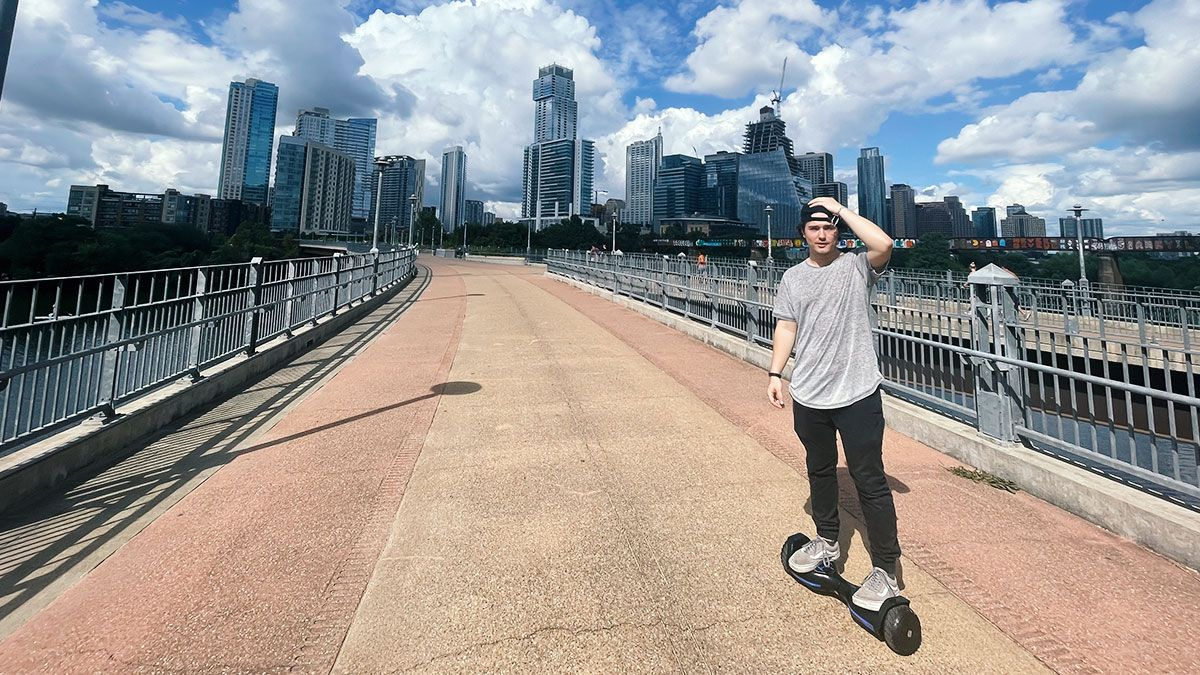 DJ Liquid Candi on his T580 Warrior hoverboard outside
