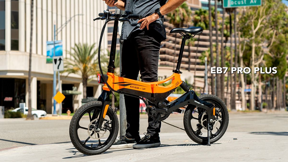 Guy on his smartphone, standing next to the EB7 Pro Plus electric bike.