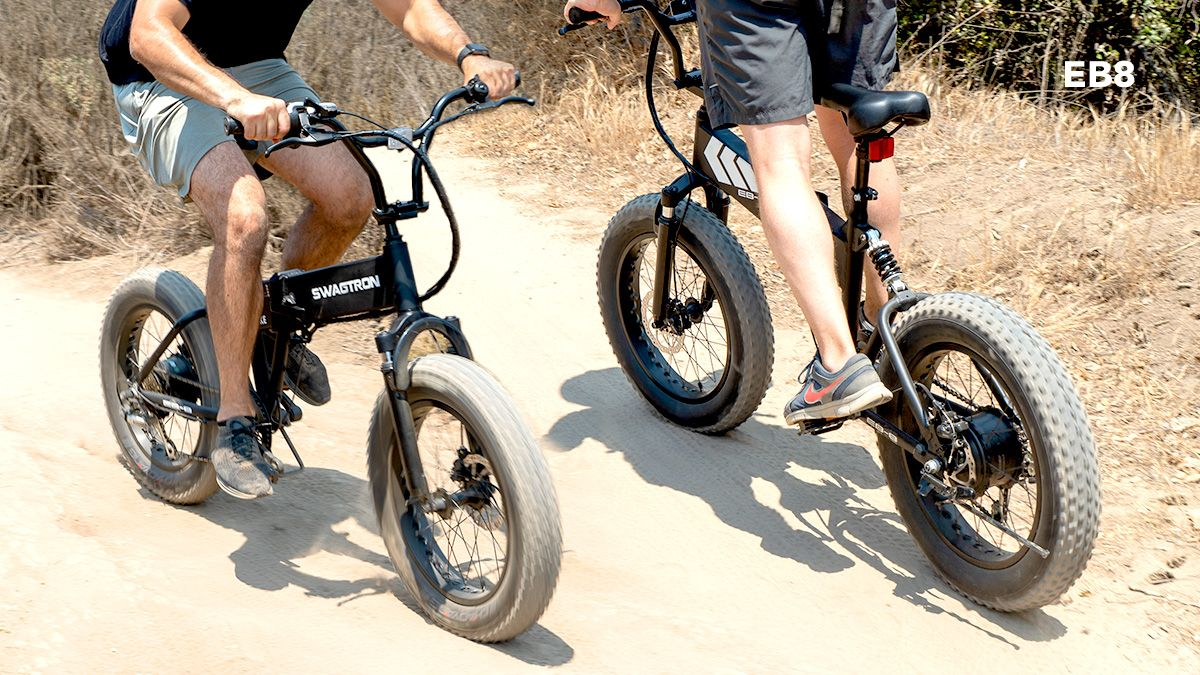 Two guys riding on a dirt trail on their EB8 All-Terrain eBikes.
