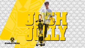 Josh Jolly holding an NG2 electric longboard