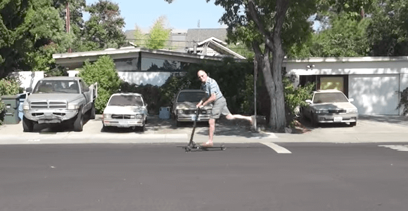 dad on electric scooter