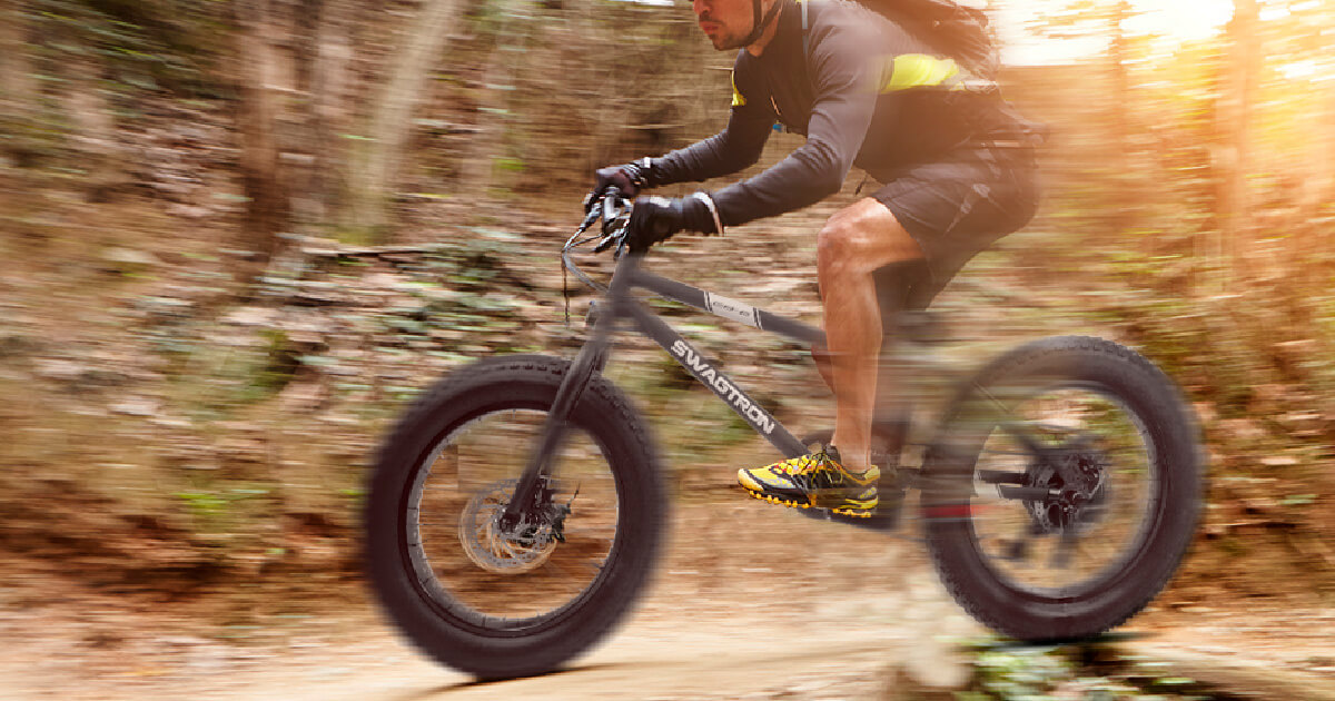Man riding at top speed on EB-6, showing ebikes are for fun and fitness